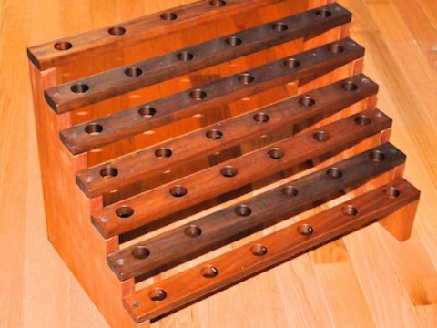 Mahagony wine plug rack w- walnut ring holders and plugs 109